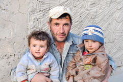Man and his children in Tajikistan Stock Photography