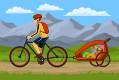 Man and his children traveling cycling together outdoor. Moutain Landscpape Background. Man and his children traveling cycling together. Father tows bike trolley Royalty Free Stock Photography