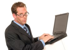 Man at his computer. Businessman typing on his computer laptop on white backdrop Stock Photos