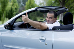 Man with his convertible car stock image
