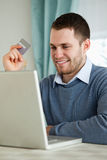 Man with his credit card on his laptop Stock Photos