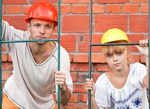 Man and his daughter as a construction workers Stock Photography