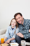 Man and his daughter having the breakfast Royalty Free Stock Photos