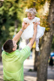The man and his daughter in her arms. Royalty Free Stock Photos