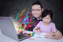 Man with his daughter and laptop Royalty Free Stock Image