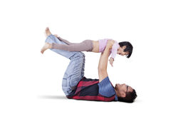 Man and his daughter playing together Stock Images