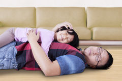 Man and his daughter relaxing on the floor Stock Photography