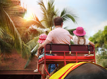 Man and his daughters riding on the back of elephant Royalty Free Stock Photos