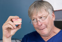 Man and his dentures royalty free stock images