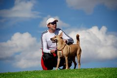 Man and his dog. Man having a break with his dog, cloudy background Stock Images