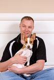 Man and his dog. Portrait of a man with his terrier stock images