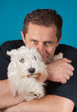 Man and his dog. Man and his adorable schnauzer dog Royalty Free Stock Photo