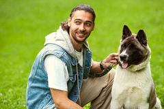 Man with his dog breed Aki Stock Image