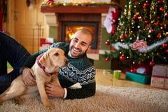 Man with his dog on Christmas eve Stock Photo