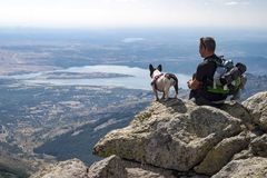Man with his dog enjoying the views royalty free stock photography