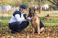 Man And His Dog German Shepherd Royalty Free Stock Photography
