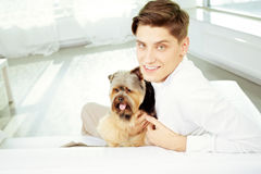 Man with his dog at home Royalty Free Stock Photos