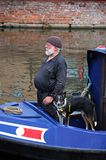 Man and his dog on a narrowboat. Stock Photo