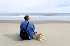 Man and His Dog at Ocean Royalty Free Stock Photo