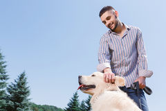 Man with his dog in the park Stock Image