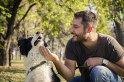 Man with his dog Stock Photography
