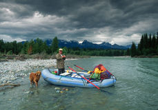 Man and his Dog Rafting North Fork of the Flathead River Stock Images