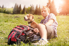 Man with his dog rest on the mountain hill Royalty Free Stock Photo