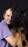 A man and his dog sit together Stock Photos
