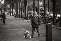 Man and his dog, street portrait, similar posture