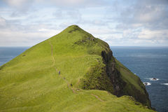 Man and his dogs hiking on Mykines Stock Photos