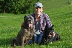 Man with his dogs Stock Photography