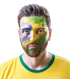 Man with his face painted with the Brazilian Flag on white background Royalty Free Stock Images