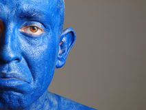 Man with his face painted with color blue (2) Stock Photo