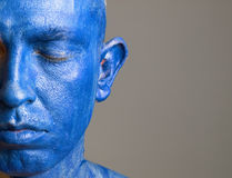 Man and his face painted with color blue (3) Stock Photo