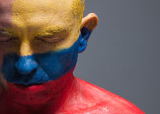 Man and his face painted with the flag of Colombia. Royalty Free Stock Image