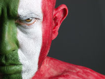 Man and his face painted with the flag of Italy Royalty Free Stock Photo