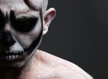 Man with his face painted with a skull Royalty Free Stock Image