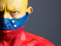 Man and his face painted with Venezuelan flag. Royalty Free Stock Photography