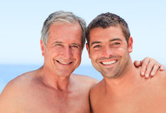 Man with his father-in-law. At the beach Royalty Free Stock Photos