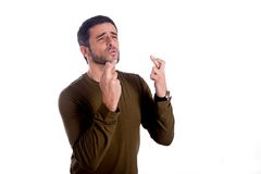 Man with his fingers crossed Royalty Free Stock Images