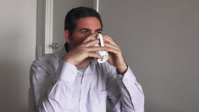Man in his forties (40s) drinking a hot drink. Man age concept - copy space stock video footage