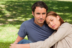 Man with his friend who is resting her head on his shoulder Stock Photo