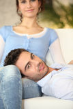Man on his girlfriend's lap Royalty Free Stock Images