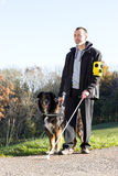 Man with his guide dog Royalty Free Stock Photography