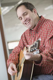 Man with with his guitar Stock Photography