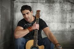 Man with his guitar. Royalty Free Stock Images