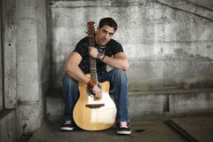 Man with his guitar Royalty Free Stock Images