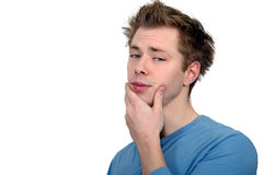 Man with his hand on chin Stock Photos