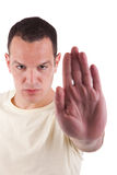 Man with his hand raised in signal to stop Stock Photos
