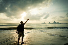 Man with his hand up on the dawn Royalty Free Stock Photos